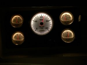 Driving at night, checking gauges