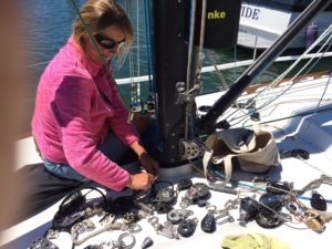 Lori working on rigging the spinnaker cars together